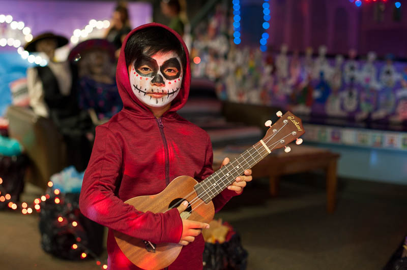 Child dressed up like Miguel from Coco.
