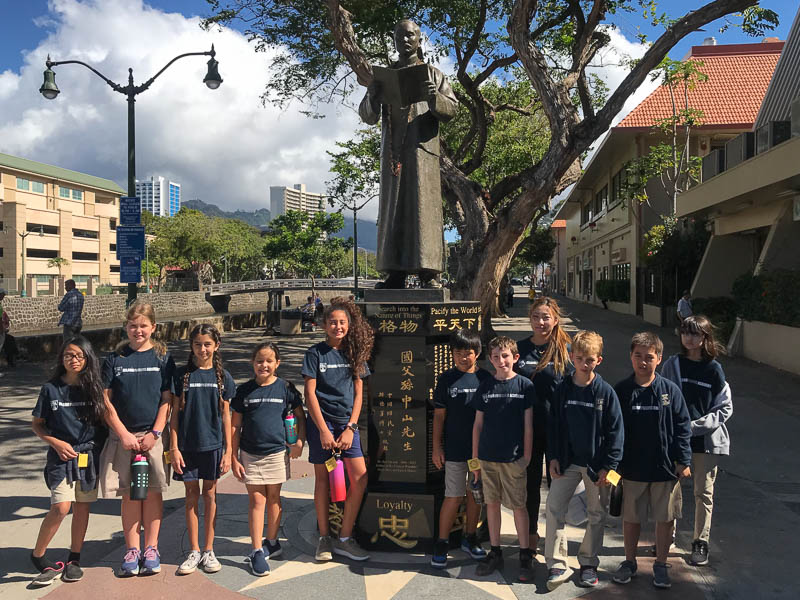 Grade 5 students in front of a statue of Sun Yat-Sen
