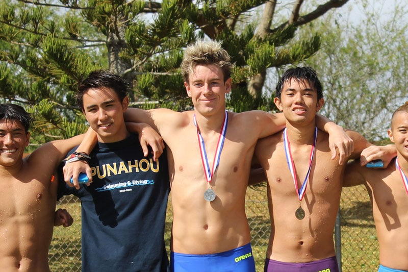 Swimmers with medals around their necks.