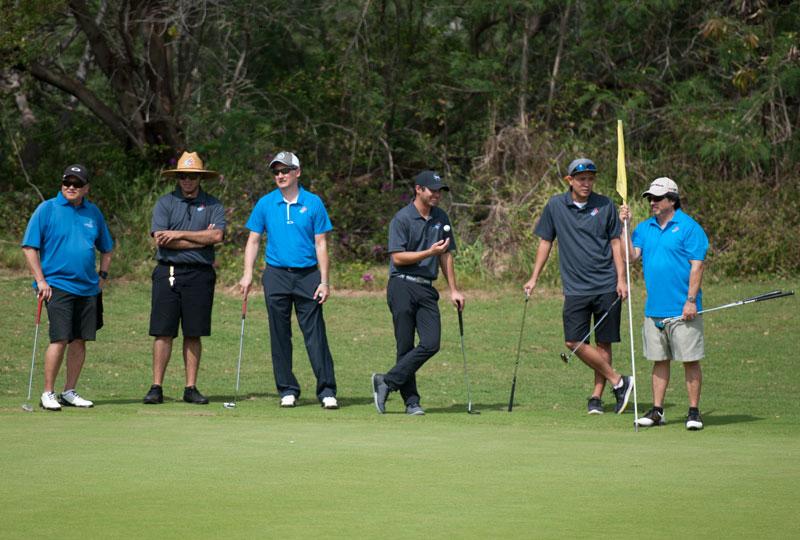 Golfers waiting on green.