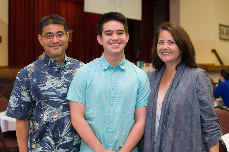 Jake Arakawa ('17) and his parents.