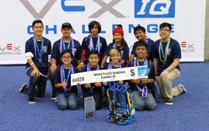 The 2016-2017 ISLAND PACIFIC ACADEMY Navigator Robotics Team at the 2017 VEX IQ World Championship in Louisville, KY. Back row: Colton Okimoto ('18), Taylor Horita ('22), Zaheer Gulko ('22), Emma-Rose Layaoen ('22), Ryan Corpuz ('22), Coach Robyn Cabuslay ('14). Front row: Sebastian Banquil ('23), Aaron Sasaki ('23), Nathan Okimoto ('22), and Joshua Kuakini ('22).