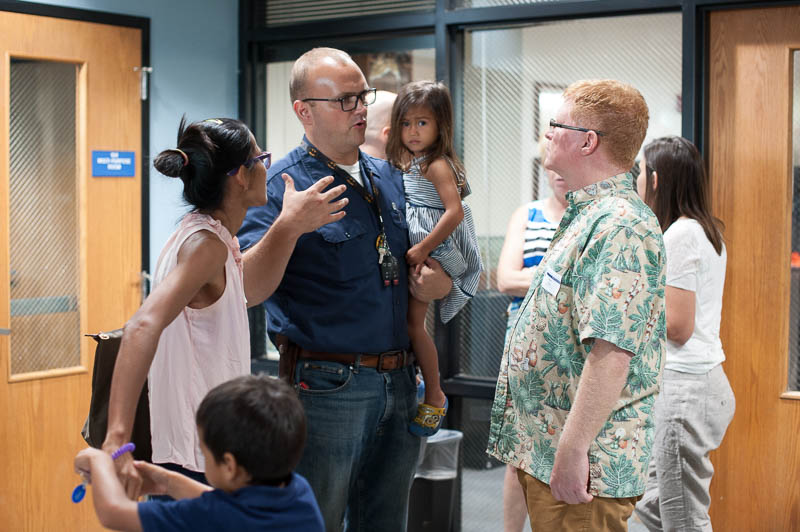 Mr. Steve Ross, Elementary Principal, connects with a new family at the New Parent Reception.