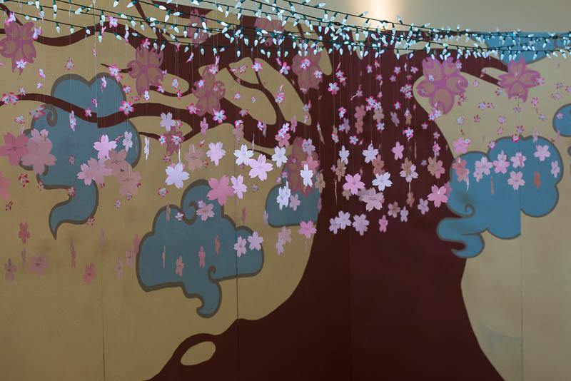 Navigate the Way display with sakura blossoms.