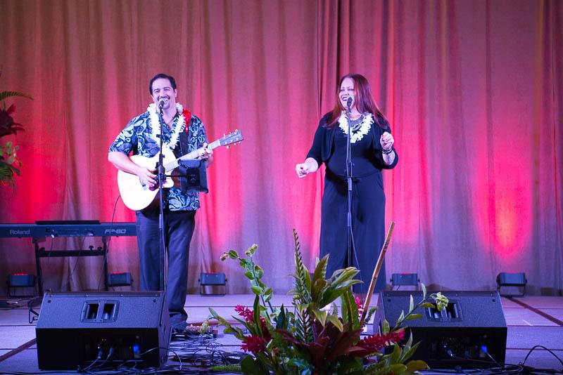 Amy Hānaialiʻi Gilliom on stage.