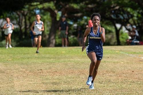 Girls cross country runner sprints to finish line