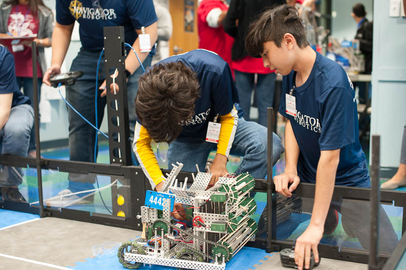 Zaheer Gulko ('22) and Nathan Okimoto ('22) – Team 4442A with Ryan Corpuz ('22) – make last minute adjustments to their robot.