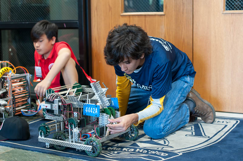 Zaheer Gulko ('22) makes sure their robot is ready to compete.