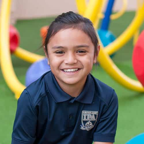 Grade 3 student smiling in playground