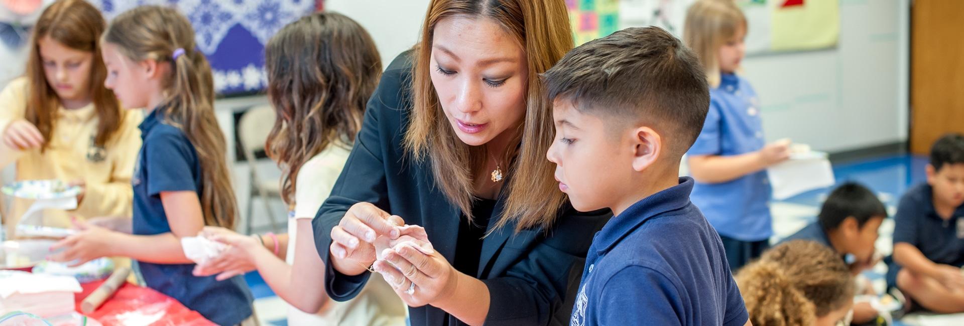 Mandarin teacher helping student.