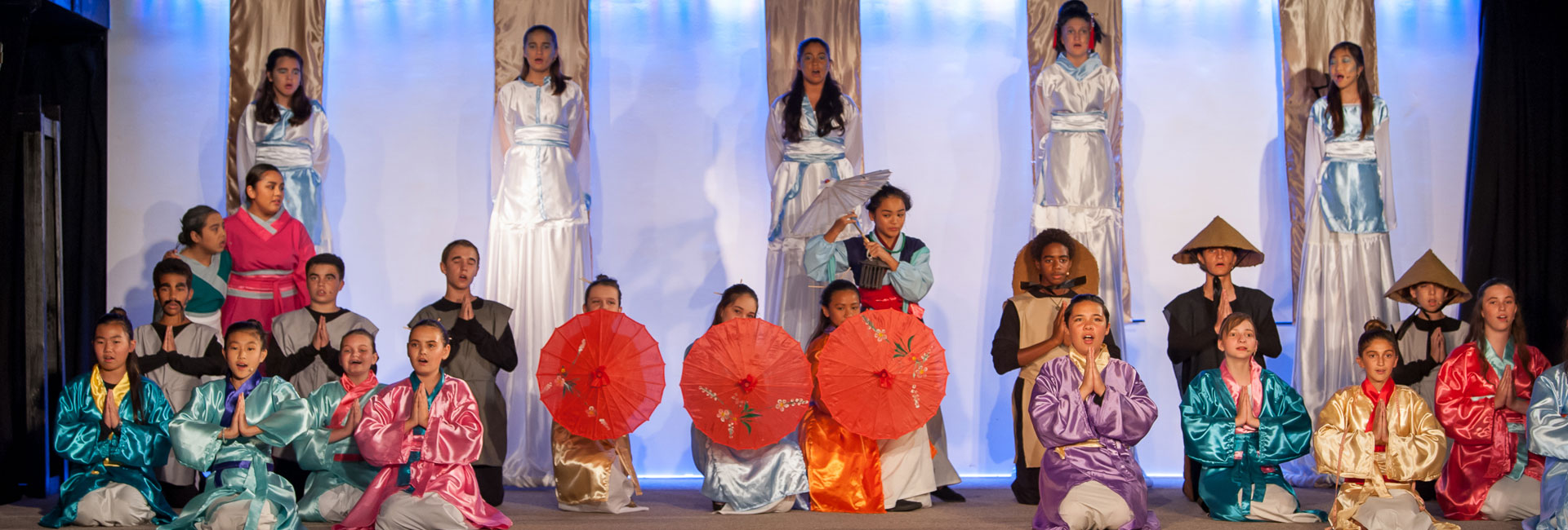 Student cast of Mulan on stage