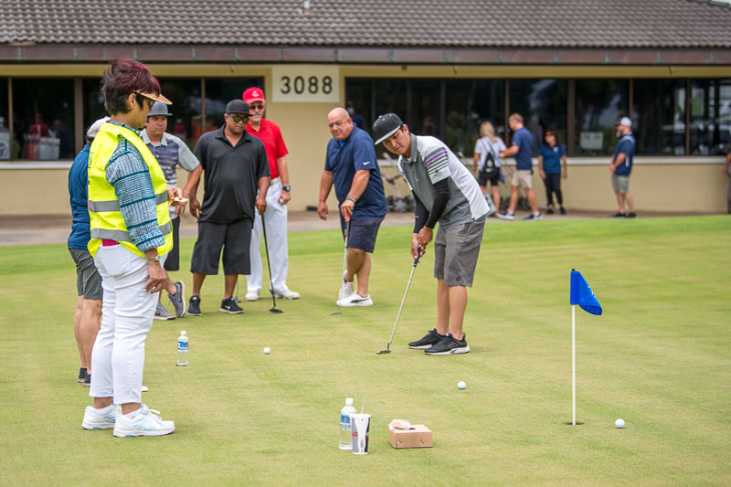 Golfers participating in putting contest