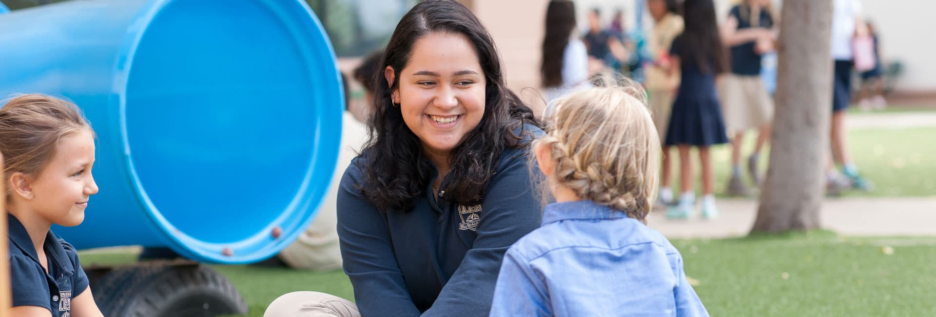 High school student talking with kindergartener