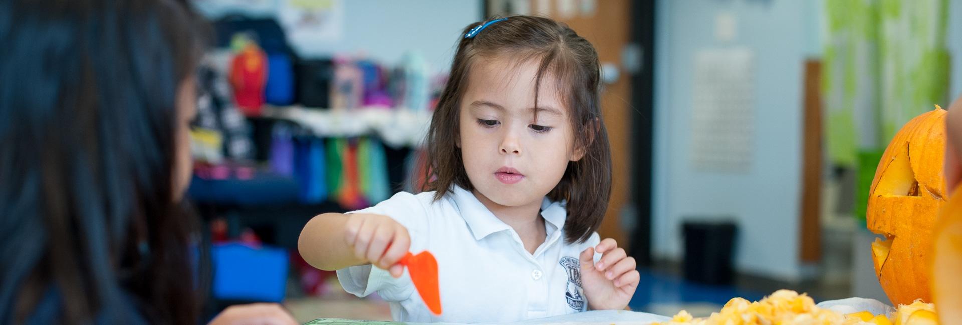 Kindergarten girl practicing counting