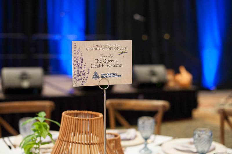 Sponsor sign on gala event table.