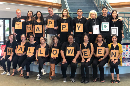 Group photo of elementary faculty on Halloween