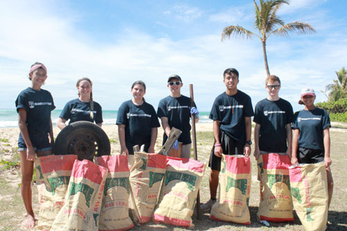 Group of students at beach cleanup
