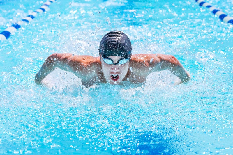 High school swimmer doing butterfly stroke