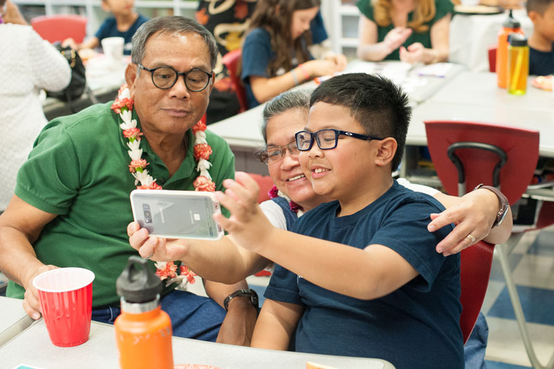 Grade 3 student taking selfie with grandparents