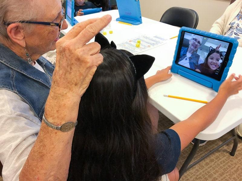 Grade 2 student and senior take selfie on iPad
