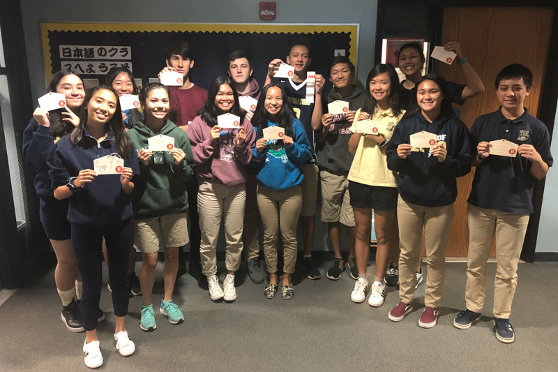 Japanese language students show off their wishes and fortunes for new year