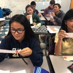 Japanese language students read their fortune strips for the new year