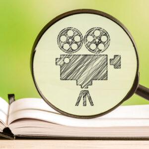 Book with pencil sketch of movie projector