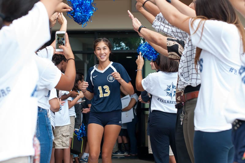 Volleyball player runs through fan tunnel