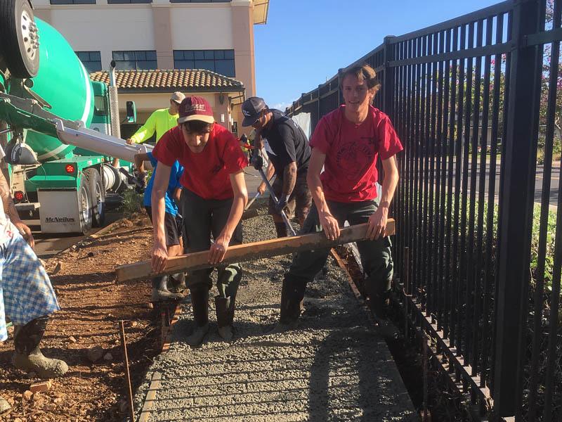 Troop members spread concrete