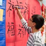 Student in Mandarin practices calligraphy