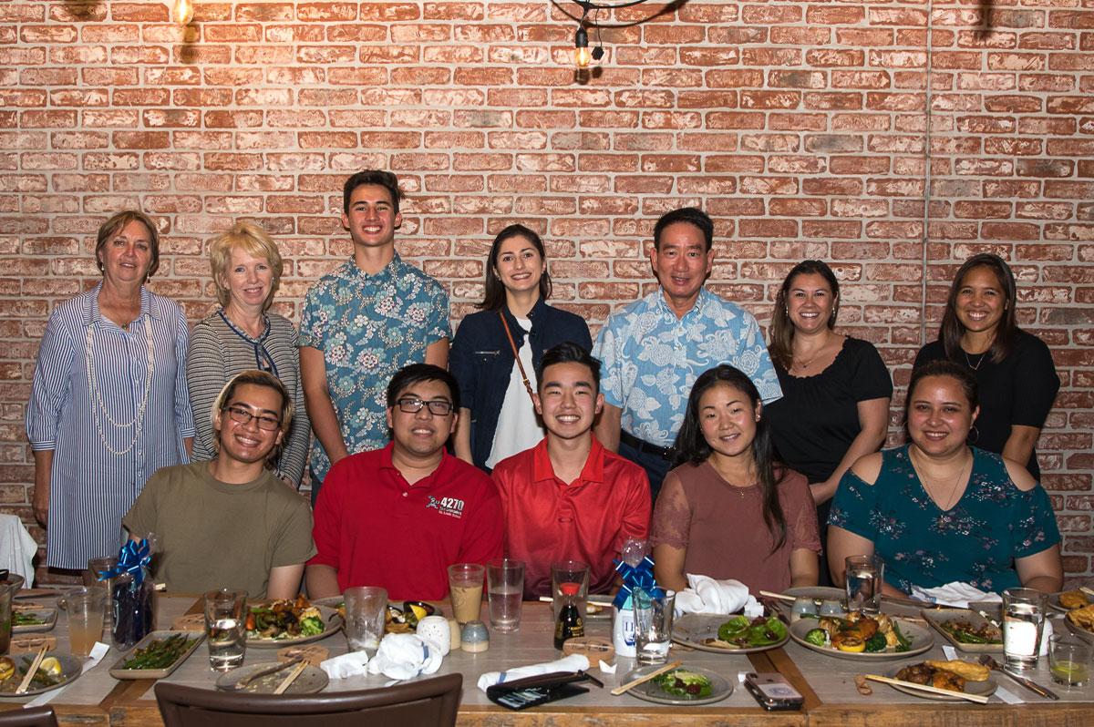 Group photo of alumni at restaurant social