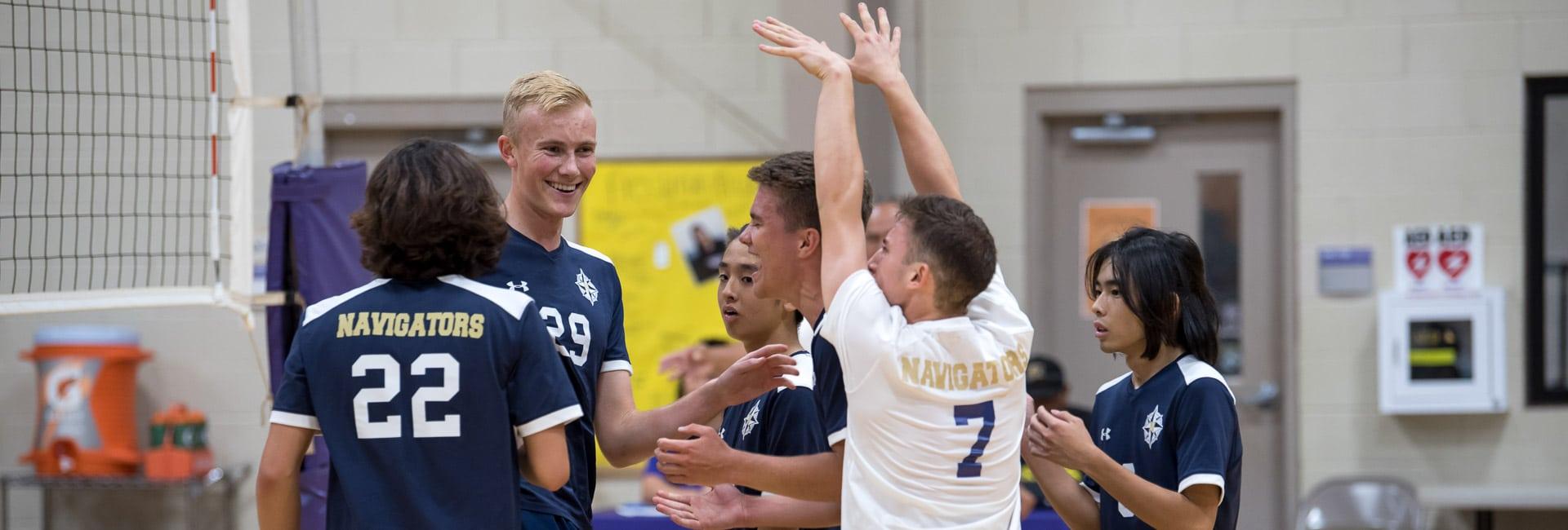 Varsity boys volleyball team celebrating