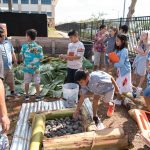 Grade 4 students help to build the umu.