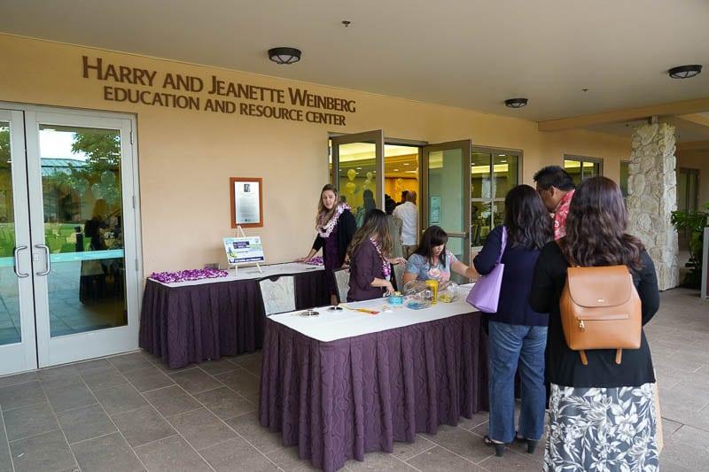 Guests wait in registration line