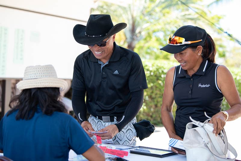 Well-dressed golfers check in a registration table
