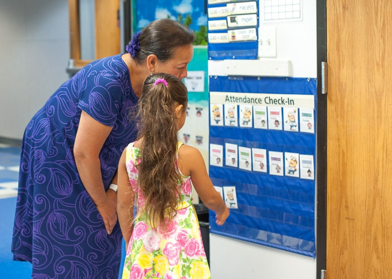 Kindergarten teacher greets new student at meet and greet