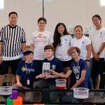 Winning robotics team poses for photo.