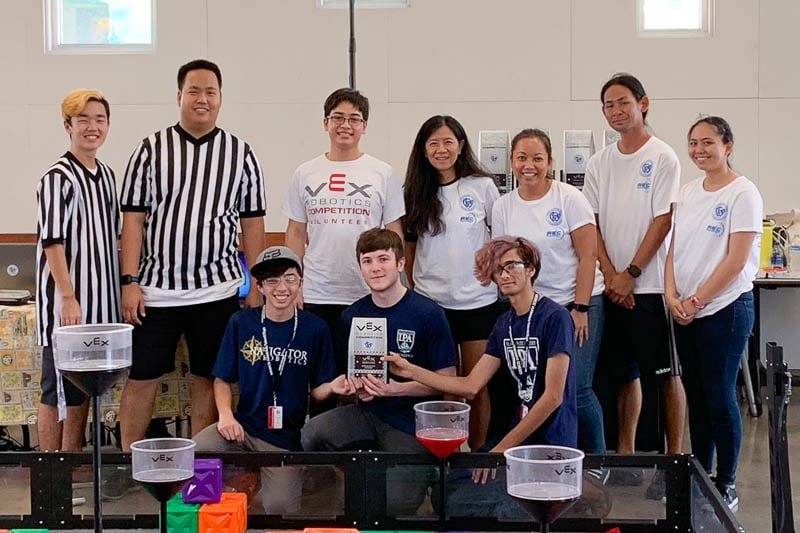 Winning robotics team poses for photo.