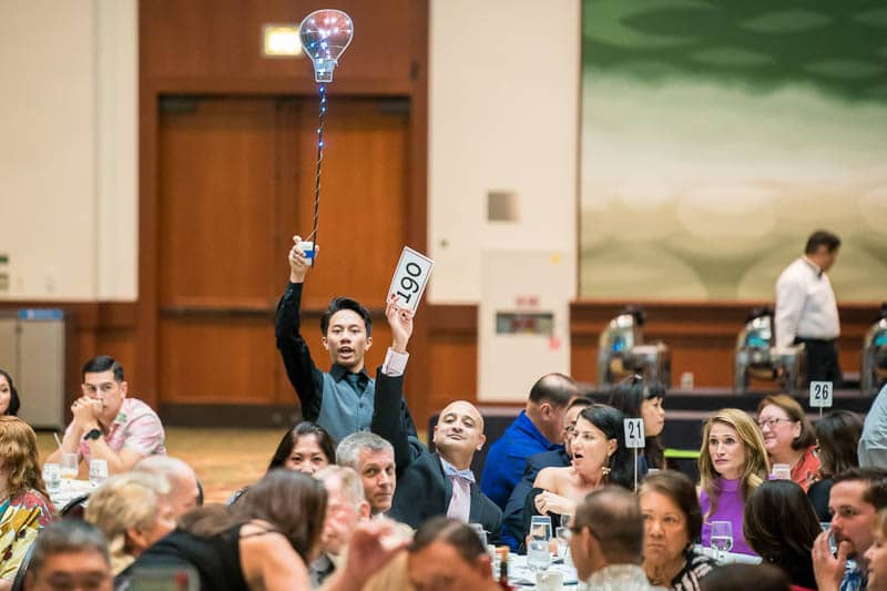 Guests bid during live auction
