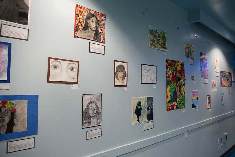 Student artwork displayed on wall