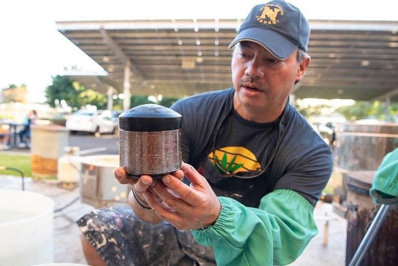 Warren Andrade examines raku fired pot