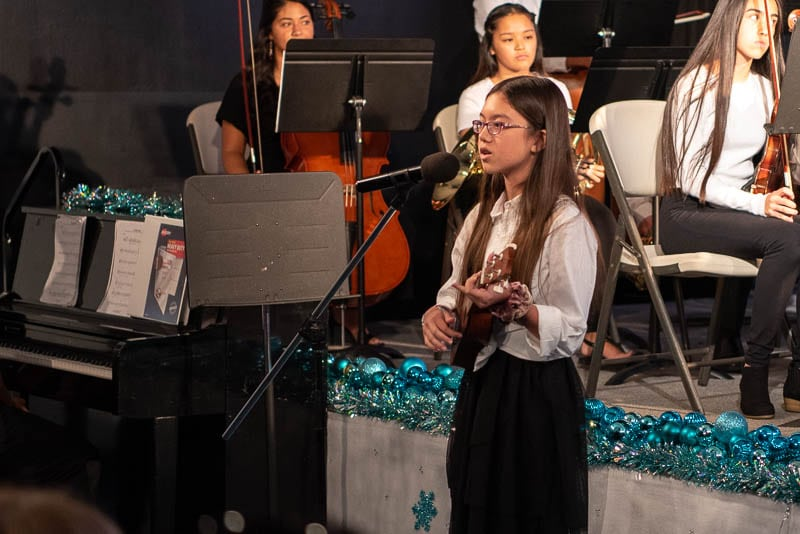 Student performs solo at music concert
