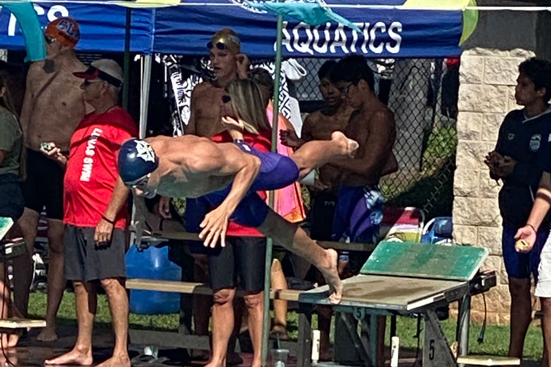 Swimmer diving off the block