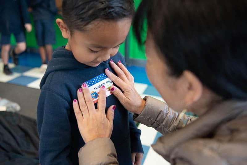 Kindergarten student getting I Voted sticker