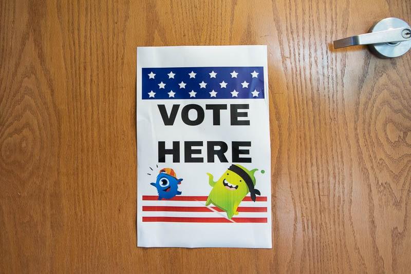 Vote Here sign on school door