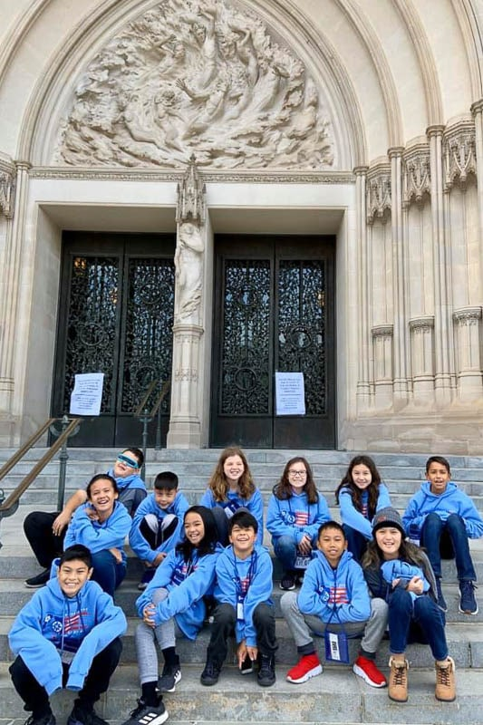 Students on steps of the National Cathedral.