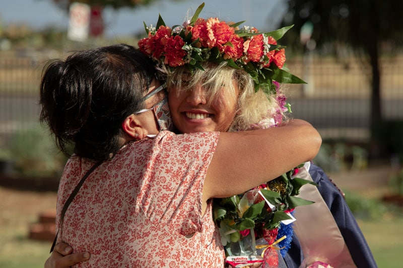 Graduate getting lei