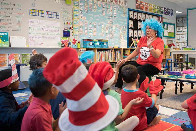 Ms. Momi having fun celebrating Dr. Seuss's birthday with her kindergarten students.