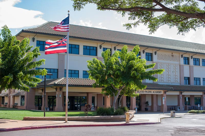 Front of secondary building with flag flying