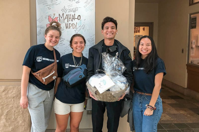 Students deliver gift basket to police department